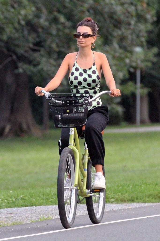 emily ratajkowski, shirt, inamorata woman, green, sneakers, sweatpants, beach, bike