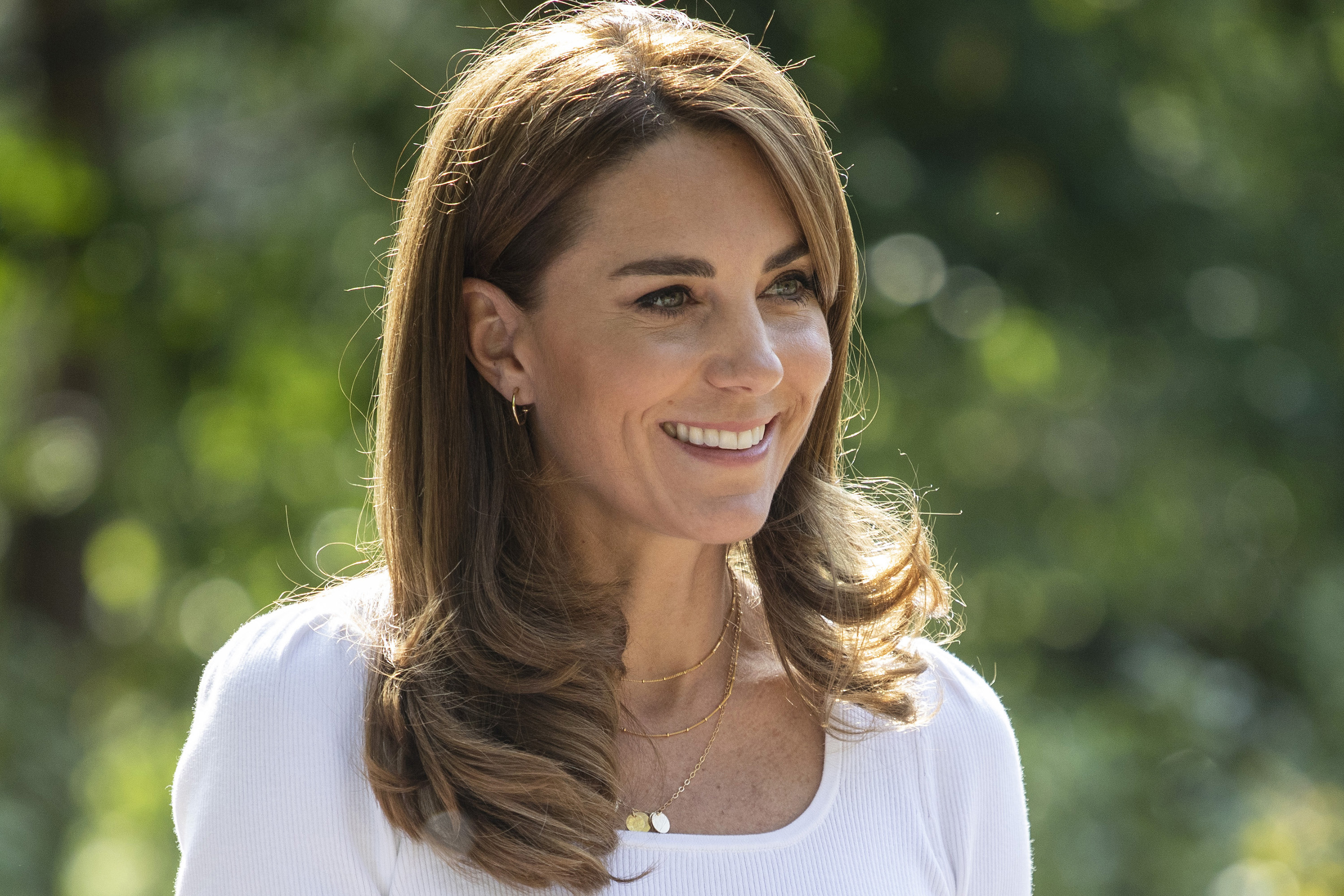 Kate Middleton Dresses Down in Recycled Pink Pants & Casual White Sneakers