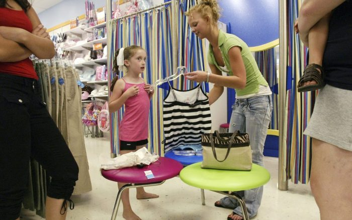 ** FILE **  In this Aug. 15, 2006 file photo, Justice salesperson Ashley Kuhn, right, helps eight-year-old Alexandria Cookson, pick out a new dance outfit at a Justice store in Columbus, Ohio. The announcement by Tween Brands Inc. that its president is resigning is the latest high-level departure by the girls' specialty retailer, which has struggled in recent quarters with slowing clothing sales.  (AP Photo/Jay LaPrete, file)