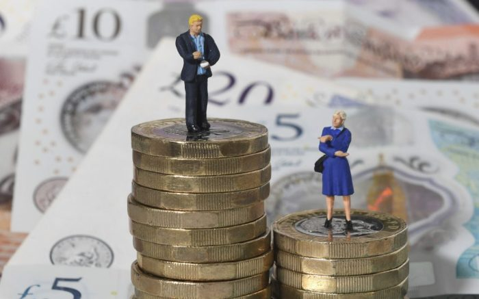 Gender pay gap. File photo dated 11/09/18 of models of a man and woman on a pile of coins and bank notes. A new study suggests slight progress has been made closing the gender pay gap in the UK in recent years/ Issue date: Wednesday March 27, 2019. Research by jobs site Glassdoor indicated that the overall difference between pay for men and women had fallen by 5% to 17.9% in the past three years. See PA story INDUSTRY Pay. Photo credit should read: Joe Giddens/PA Wire URN:41998089 (Press Association via AP Images)