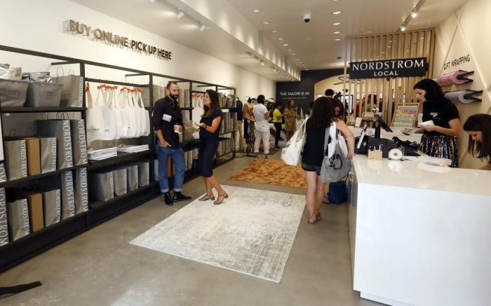"People visit the Nordstrom Local store, in New York's Upper East Side, Thursday, Sept. 5, 2019. The new store that Nordstrom opened carries no merchandise and instead offers tailoring services and allows customers to pick up or return online orders. The Upper East Side location is the first Nordstrom ""mini store"" in New York. (AP Photo/Richard Drew)"
