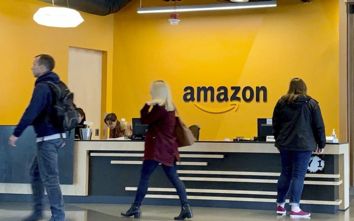 Photo taken in September 2019 shows employees at Amazon.com Inc.'s headquarters in Seattle. (Kyodo via AP Images) ==Kyodo