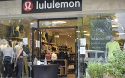 A Lululemon Athletica employee wears a