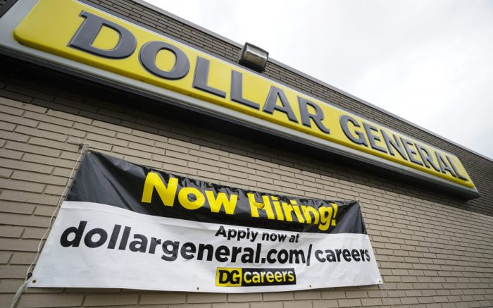 A help wanted sign is displayed at the Dollar General store in Cicero, Ind., Wednesday, Sept. 2, 2020. (AP Photo/Michael Conroy)