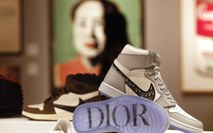 A pair of Dior X Nike Air Jordan 1 High OG 2020 sneakers at Bonhams auction house in London, Thursday, Oct. 1, 2020. The pair is valued at 10,000-12,000 UK pounds (13,000-15,000 US dollars, when sold as part of the Pop Culture auction on Oct. 8. (AP Photo/Alastair Grant)