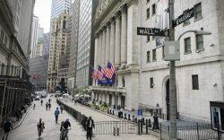 Pedestrians pass the New York Stock