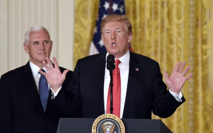 File photo dated June 18, 2018 President Donald Trump speaks as Vice President Mike Pence looks on during a meeting with the National Space Council in the East Room of the White House, in Washington, DC, USA. Vice President Mike Pence and his wife Karen have tested negative for the coronavirus, his press secretary announced in a tweet. Pence is first in line to assume power if President Donald Trump, who tested positive for the virus on Thursday night and arrived Friday at Walter Reed National Military Medical Center, were incapacitated. Photo by Olivier Douliery/Abaca/Sipa USA(Sipa via AP Images)