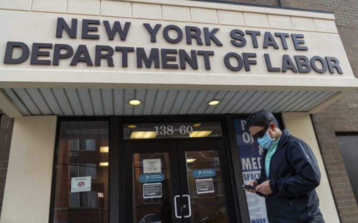 A man wearing a face mask as a preventive measure walks past the New York State Department of Labor in Flushing, Borough of Queens, New York. Social Security Announces 1.3 Percent Benefit Increase for 2021 (Photo by John Nacion / SOPA Images/Sipa USA)(Sipa via AP Images)