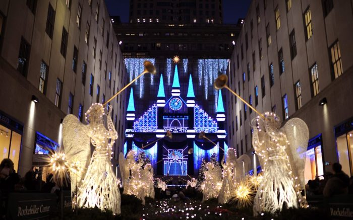 A timed light show is seen on display on the Fifth Avenue facade of Saks Fifth Avenue through the gardens of Rockefeller Center in New York, NY, on December 4, 2015. (Photo by Anthony Behar) *** Please Use Credit from Credit Field ***