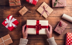 Man holding Christmas presents laid on