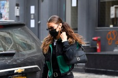 Bella Hadid Steps Out to Vote in North Face Fleece Jacket & All-Black Converse