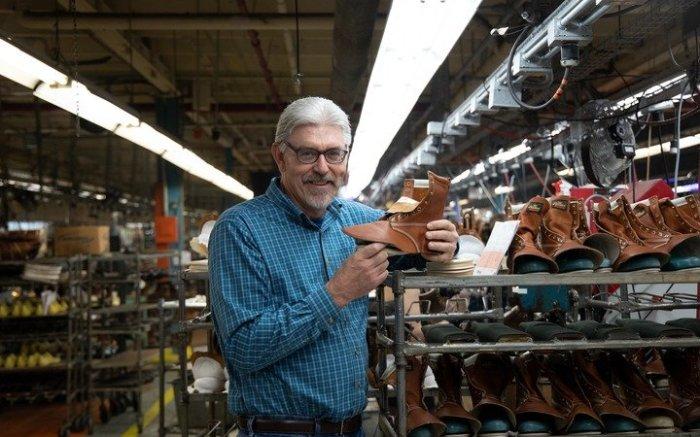 Thorogood President Jeff Burns holding a workboot