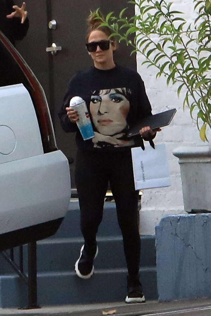 Jennifer Lopez was spotted leaving skincare center in Beverly Hills wearing a sweater with Barbra Streisand on it. 15 Oct 2020 Pictured: Jennifer Lopez. Photo credit: MEGA TheMegaAgency.com +1 888 505 6342 (Mega Agency TagID: MEGA708071_003.jpg) [Photo via Mega Agency]