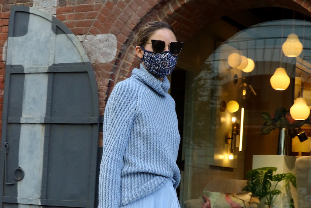 Olivia Palermo Pairs A Light Blue Sweater & Midi Skirt With These Dior Combat Boots