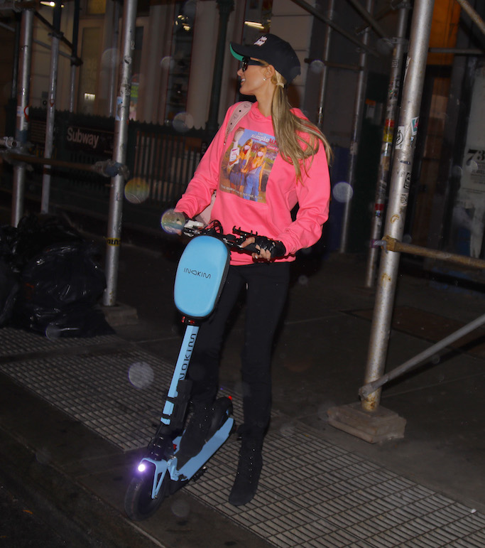 EXCLUSIVE: Paris Hilton wears a 'Make America Hot again' cap and the Simple Life sweater while riding a scooter in NYC. She was seen showing off her new $1000 MCM pink 'Speaker Backpack'. 30 Oct 2020 Pictured: Paris Hilton. Photo credit: MEGA TheMegaAgency.com +1 888 505 6342 (Mega Agency TagID: MEGA711622_005.jpg) [Photo via Mega Agency]