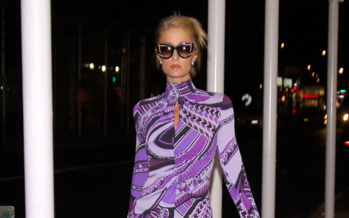 EXCLUSIVE: Paris Hilton seen out in NYC wearing a purple mini dress. Paris was seen taking an evening stroll in the Soho district of NYC, wearing sunglasses and matching face mask. 29 Oct 2020 Pictured: Paris Hilton. Photo credit: MEGA TheMegaAgency.com +1 888 505 6342 (Mega Agency TagID: MEGA711415_002.jpg) [Photo via Mega Agency]
