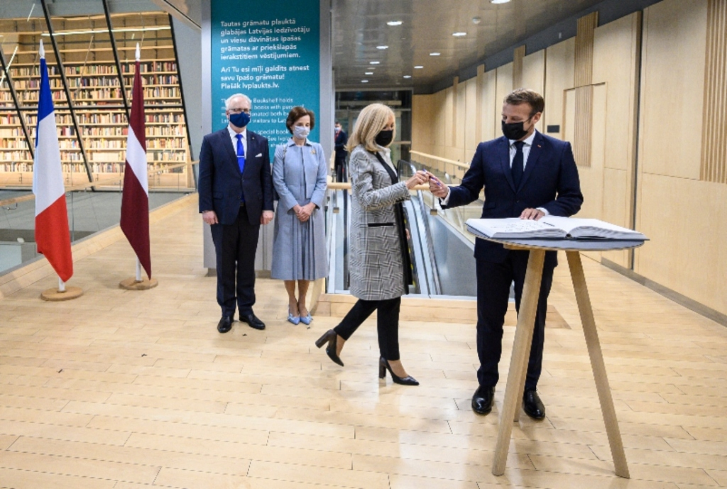 brigitte macron, heels, coat, dress, jeans, pants, jacket, louis vuitton, france, french, emmanuel macron, latvia