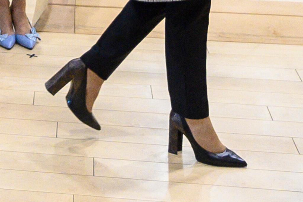 brigitte macron, heels, coat, dress, jeans, pants, jacket, louis vuitton, france, french, emmanuel macron, latvia