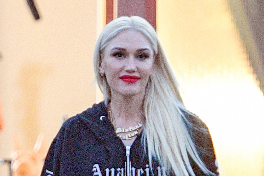 Gwen Stefani Goes 'Discoball'-Chic in a Metallic Bodysuit, Fishnets & Crystal Combat Boots