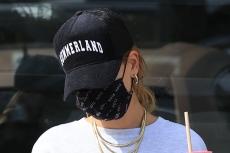 Hailey Baldwin Covers Her Tie-Dye Shorts in Baggy Sweats & 'Oreo' Adidas With Addison Rae
