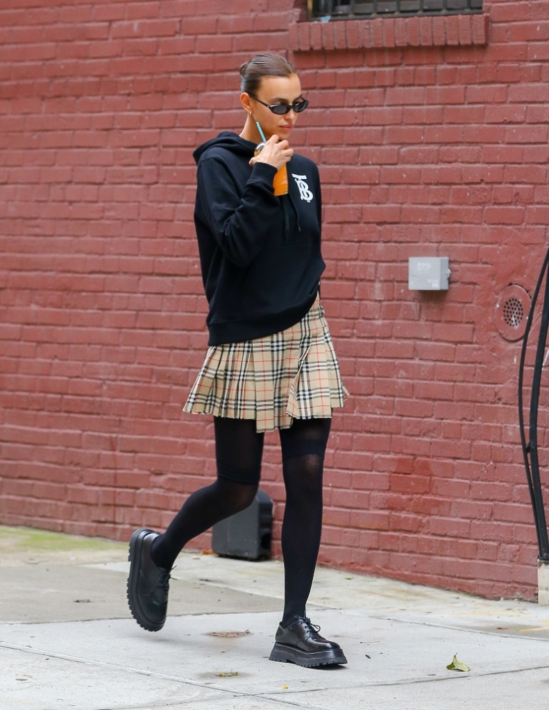 irina shayk, cutout shirt, leather, pants, leggings, boots, dr martens, tie-dye, style, new york, skirt