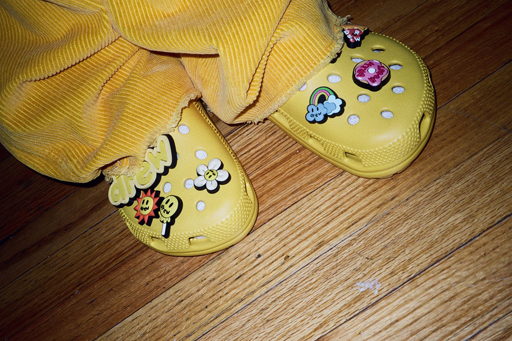 "Justin Bieber has teamed up with Crocs to design his own pair of Classic Clogs, as well as eight custom Jibbitz charms, which 'match his good vibes and laid-back style'. The limited edition collection launches globally on October 13. Bieber said: ""As an artist, it's important that my creations stay true to myself and my style. I wear Crocs all the time, so designing my own pair came naturally. With these Crocs, I just focused on making something cool that I want to wear."" The Crocs X Justin Bieber with drew Classic Clog pulls inspiration from the signature yellow of Bieber's personal clothing brand, drew house, according to the brand. ""Croctober is a monumental time of year for Crocs fans, so it made sense to up the ante by collaborating with an authentic fan – and one of the world's biggest superstars – Justin Bieber,"" said Heidi Cooley, Head of Global Marketing for Crocs. ""Having a creative of Justin's caliber wearing Crocs shoes is of the highest compliments, and definitely hasn't gone unnoticed. But it's his belief in being true to yourself, a value we share, that makes this special partnership so authentic and exciting."" The limited-edition collaboration will be priced at $59.99 USD. Please credit Courtesy of Ryan Good/Crocs/MEGA. 08 Oct 2020 Pictured: The Crocs X Justin Bieber with drew Classic Clog pulls inspiration from the signature yellow of Bieber's personal clothing brand, drew house, and includes eight custom Jibbitz™ charms designed to match his good vibes and laid-back style. Photo credit: Ryan Good/Crocs/MEGA TheMegaAgency.com +1 888 505 6342 (Mega Agency TagID: MEGA706371_011.jpg) [Photo via Mega Agency]"