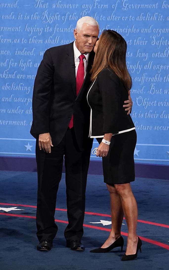 Vice President Mike Pence is kissed by his wife Karen Pence following the vice presidential debate with Democratic vice presidential candidate Sen. Kamala Harris, D-Calif., Wednesday, Oct. 7, 2020, at Kingsbury Hall on the campus of the University of Utah in Salt Lake City. (AP Photo/Patrick Semansky)