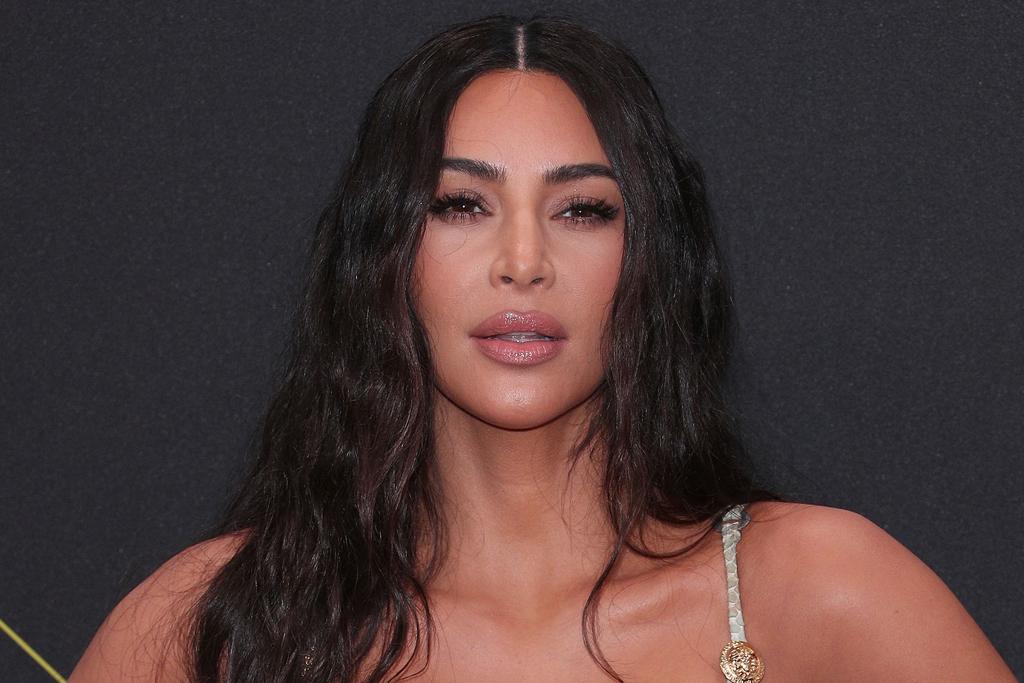 Kim Kardashian's Birthday Suit Includes a Vintage Minidress & Snaking Sandals