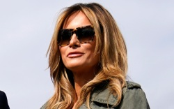 melania trump, green dress, jacket, heels,