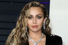 Miley Cyrus Takes the Plunge In a 1970s-Style Snakeskin Dress & Thin Heels