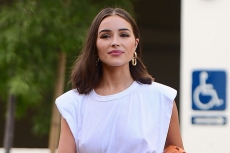 Olivia Culpo Wears Square Toe Sandals and Bold Leather Shorts to Model Her New Clothing Line