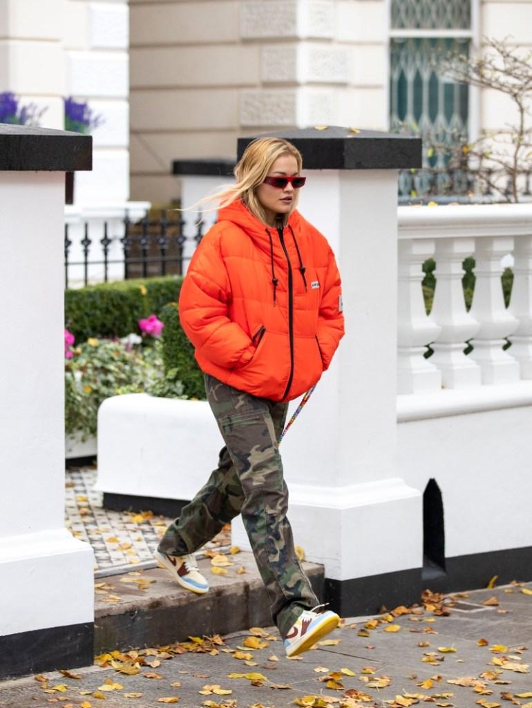 rita ora, style, pants, camo, sneakers, jacket, sunglasses, london, fearless, orange