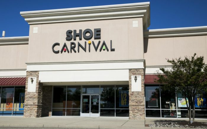 A logo sign outside of a Shoe Carnival retail store location in Newport News, Virginia on May 2, 2020. (Photo by Kristoffer Tripplaar/Sipa USA)(Sipa via AP Images)