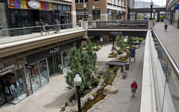 FILE - In this May 6, 2020 file photo, shoppers walk through City Creek Center in Salt Lake City. Mall owner Simon Properties said Wednesday, June 20, 2020 that it is pulling out of its $3.6 billion to buy rival Taubman, citing the coronavirus pandemic which has forced many malls to temporarily close their doors. It is the second major retail deal to fall apart due to the pandemic.   (AP Photo/Rick Bowmer, File)
