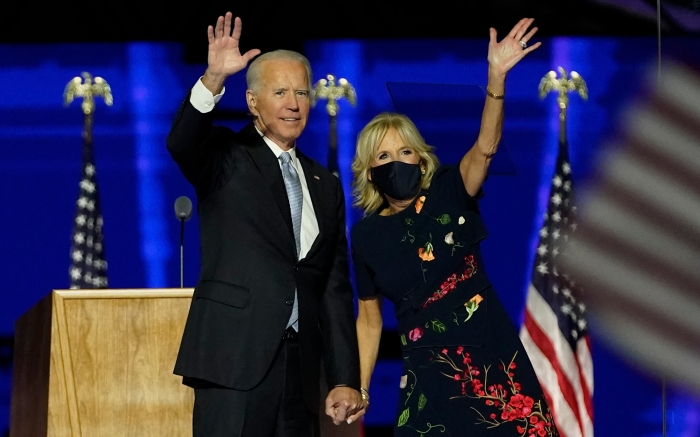President-elect Joe Biden with his wife Jill Biden waving to supporters, Saturday, Nov. 7, 2020, in Wilmington, Del. (AP Photo/Andrew Harnik, Pool)