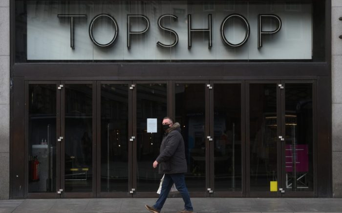 """Arcadia Group. A man walks past the Topshop flagship store at Oxford Circus, London, part of the Arcadia Group. Sir Philip Green's Arcadia retail empire has said it is working on """"contingency options to secure the future of the group's brands"""" after reports it will collapse into administration within days, with 15,000 jobs at risk. Picture date: Friday November 27, 2020. See PA story CITY Arcadia. Photo credit should read: Kirsty O'Connor/PA Wire URN:56823304 (Press Association via AP Images)"""
