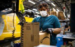 An Amazon worker wears a mask