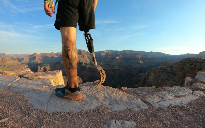 Merrell ambassador and adaptive athlete Dan Kosick is photographed in the brand's shoes.