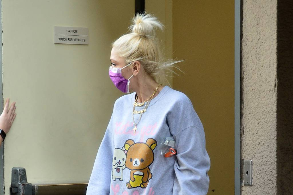 Image of article 'Gwen Stefani Pairs 'Let's Get Lazy' Sweatshirt with Embellished Jeans & Cream Vans Slip-Ons'