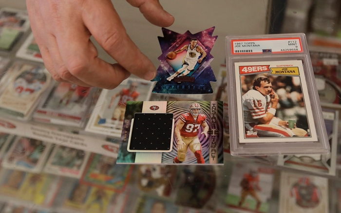Basketball football cards Steph Curry Joe Montana Nick Bosa
