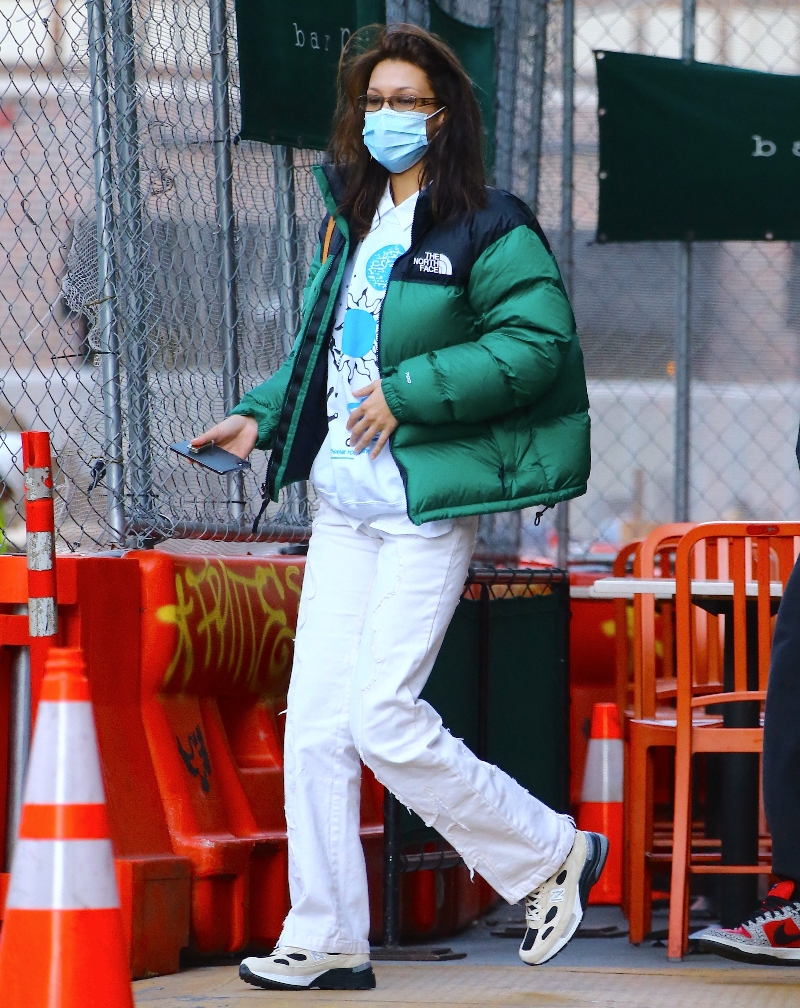 bella hadid, jeans, ripped jeans, white, sneakers, new balance, jacket, puffer, green, north face, new york