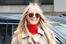 Heidi Klum Dresses Up Chunky White Sneakers and Blue Jeans with Cream Wool Coat