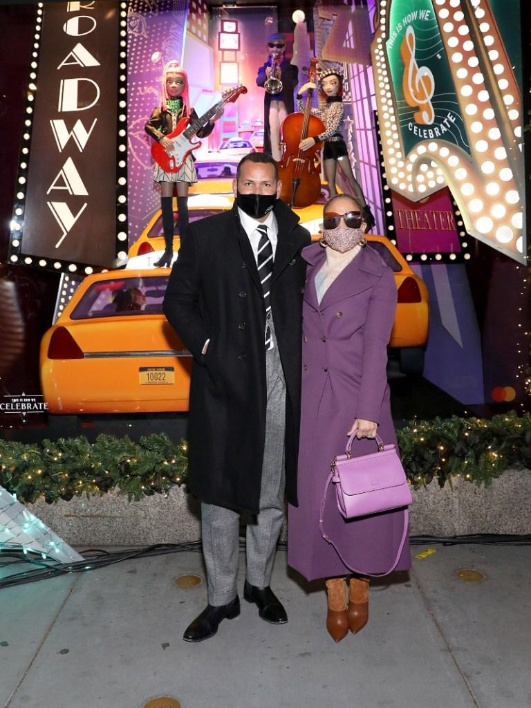 jennifer lopez, coat, dress, boots, saks, alex rodriguez, christmas, window lights, tree, new york