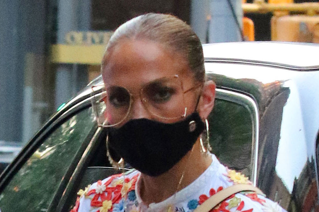 J-Lo Goes Classic for the Holidays in an One-Shoulder Top, Tailored Tr... image