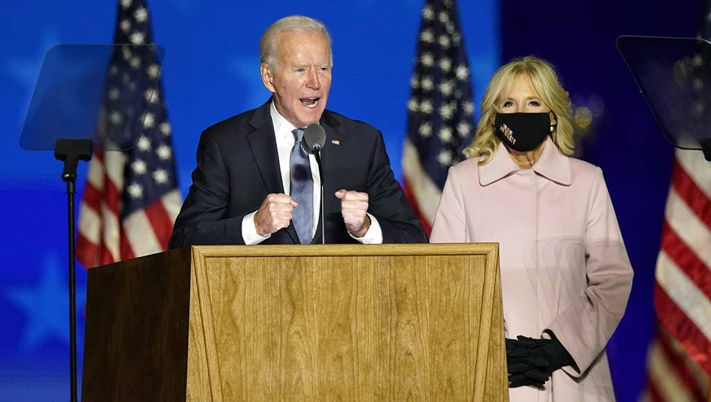 Democratic presidential candidate former Vice President Joe Biden speaks to supporters Wednesday, Nov. 4, 2020, in Wilmington, Del., as he stands next to his wife Jill Biden. (AP Photo/Andrew Harnik)