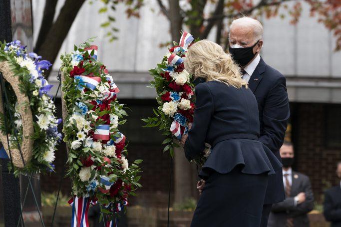 President-elect Joe Biden, and Jill Biden, place a wreath at the Philadelphia Korean War Memorial at Penn's Landing, on Veterans Day, Wednesday, Nov. 11, 2020, in Philadelphia. (AP Photo/Alex Brandon)