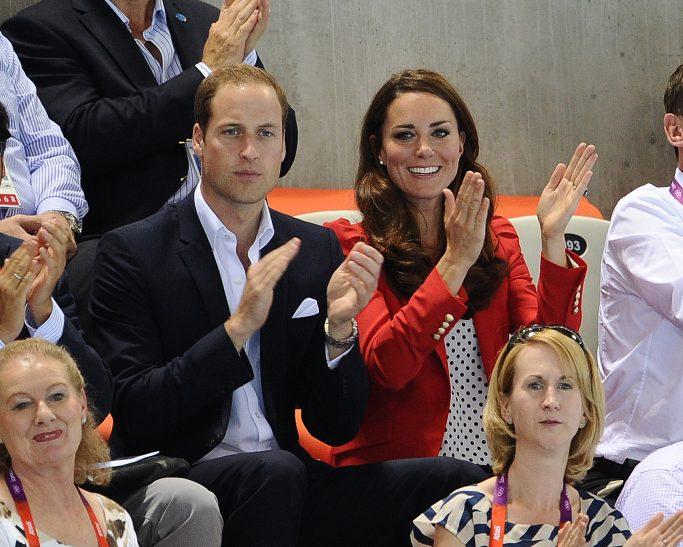 **Kate Middleton's stylish outfits of 2012** Prince William, Duke of Cambridge and Catherine, Duchess of Cambridge aka Kate MiddletonMembers of the Royal family watch a swimming event at the London 2012 Olympic GamesLondon, England - 03.08.12**Available for publication in the UK & USA only. Not for publication in the rest of the world**Mandatory Credit: WENN.com Newscom/(Mega Agency TagID: wennphotosthree560820.jpg) [Photo via Mega Agency]