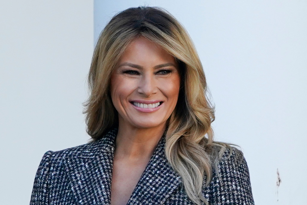 Melania Trump Layers a Tweed Coat Over a Leather Skirt to Pardon Thanksgiving Turkey