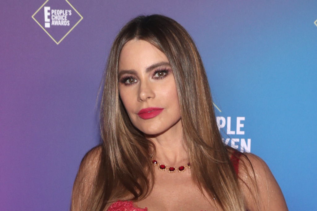 Sofia Vergara Styles a Custom Red Corset Dress With Gold Heels for Bad... image