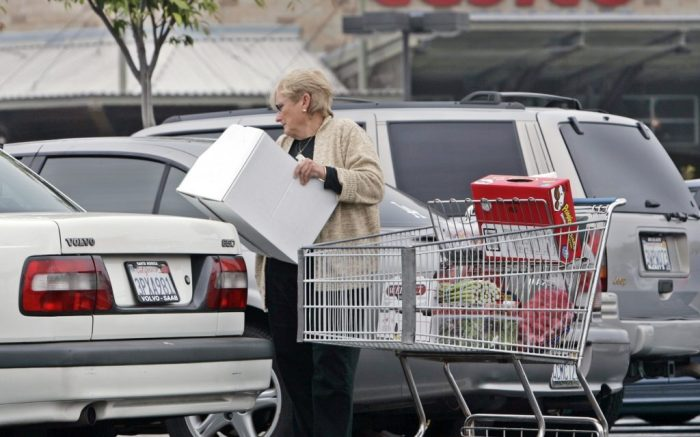 A shopper loads purchases into her car outside a Costco store in Culver City, Calif., Thursday, May 5, 2005.  Consumers overcame some of their reluctance to shop in April, giving the nation's retailers sales that modestly beat expectations. Costco Wholesale Corp. enjoyed a same-stores sales gain of 8 percent, surpassing the 6.7 percent analyst estimate. Total sales rose 11 percent.  (AP Photo/Reed Saxon)